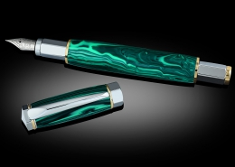 Fountain pen with magnetic cap, chrome and gold, malachite. Iridium pen nib and uses either an ink cartridge or converter pump. Pen can also be made as a rollerball.