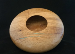 "Figured maple with turquoise inlay. 8.75"" diameter, 2"" high. Available."