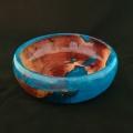 "Manzanita burl cast in blue resin; 7.75"" diameter, 2.5"" high. Available."