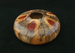 "Spalted norfolk island pine with 6 branch knots. 5.75"" diameter, 2.25"" high. Available."