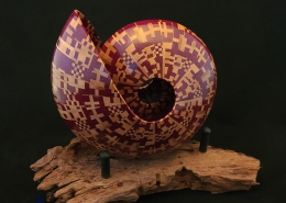 """Purple heart and maple laminated woods on driftwood base; 6.5"""" long, 6.5"""" high, 5"""" wide (without stand). Not available"""
