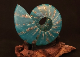 """Blue green resin cast with sea shells on mopani base; 5"""" long, 5"""" high, 4"""" wide (without stand). Not available"""
