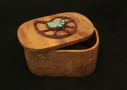 """Spalted sweetgum lidded box. 5.75"""" long, 3.75"""" wide, 3"""" high. Box lid décor 2 scroll cut walnut nautilus shaped pieces one inlaid with turquoise. Available"""