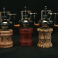 "Antique style pepper mills with adjustable grind; left to right; ambrosia maple 7"" tall, 3.25"" wide; bloodwood, 7"" tall, 3.25"" wide; spalted tamarind, 7.25"" tall, 3"" wide"