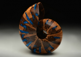 """Spalted walnut cast with blue resin; 6.5"""" long, 6.5"""" high, 5""""wide. Not available"""